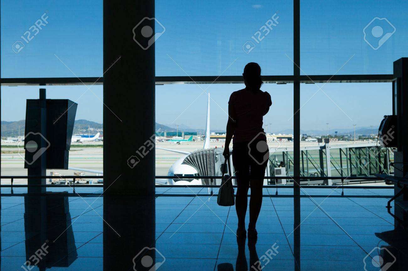 Silhouette of women talking on cell phone in airport terminal Stock Photo - 21478530