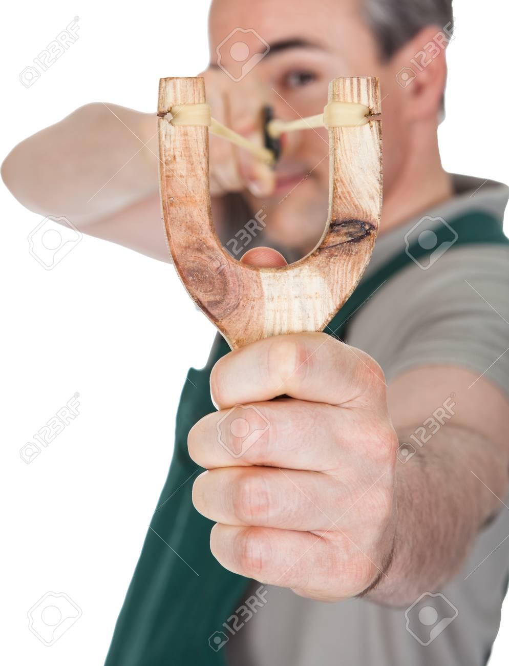 Close-up of hand pulling sling shot on white background Stock Photo - 21669443