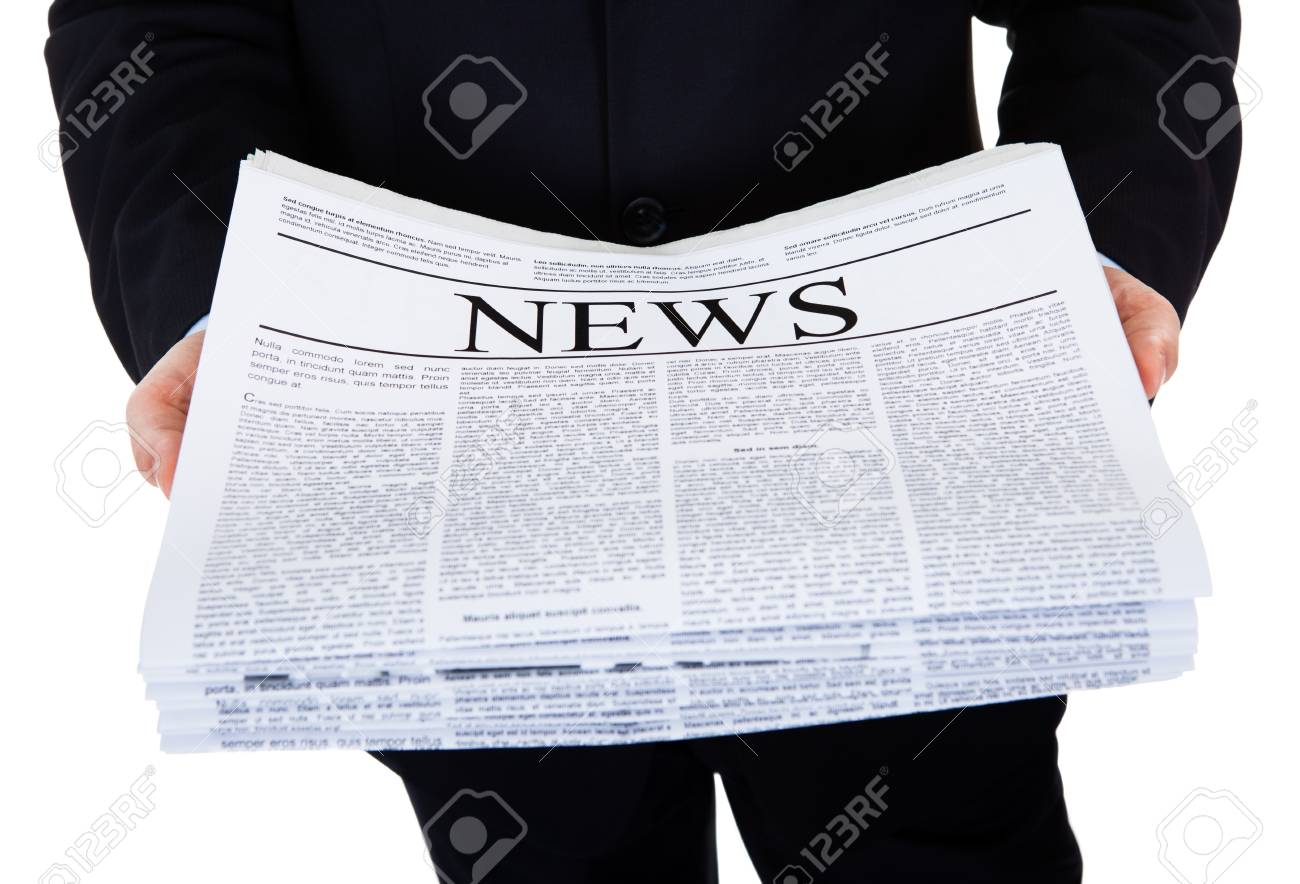 Closeup Of Businessman Holding Stack Of Newspaper Over White Background Stock Photo - 22002565
