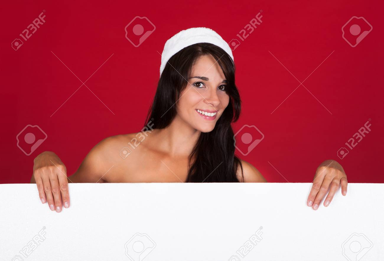 Happy Woman In Santa Costume Showing Blank White Placard Stock Photo - 22752913