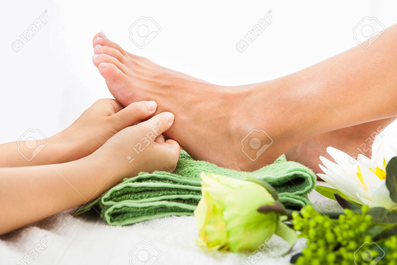 Close-up Of Woman Feet Receiving Foot Massage In Spa Stock Photo - 23345702