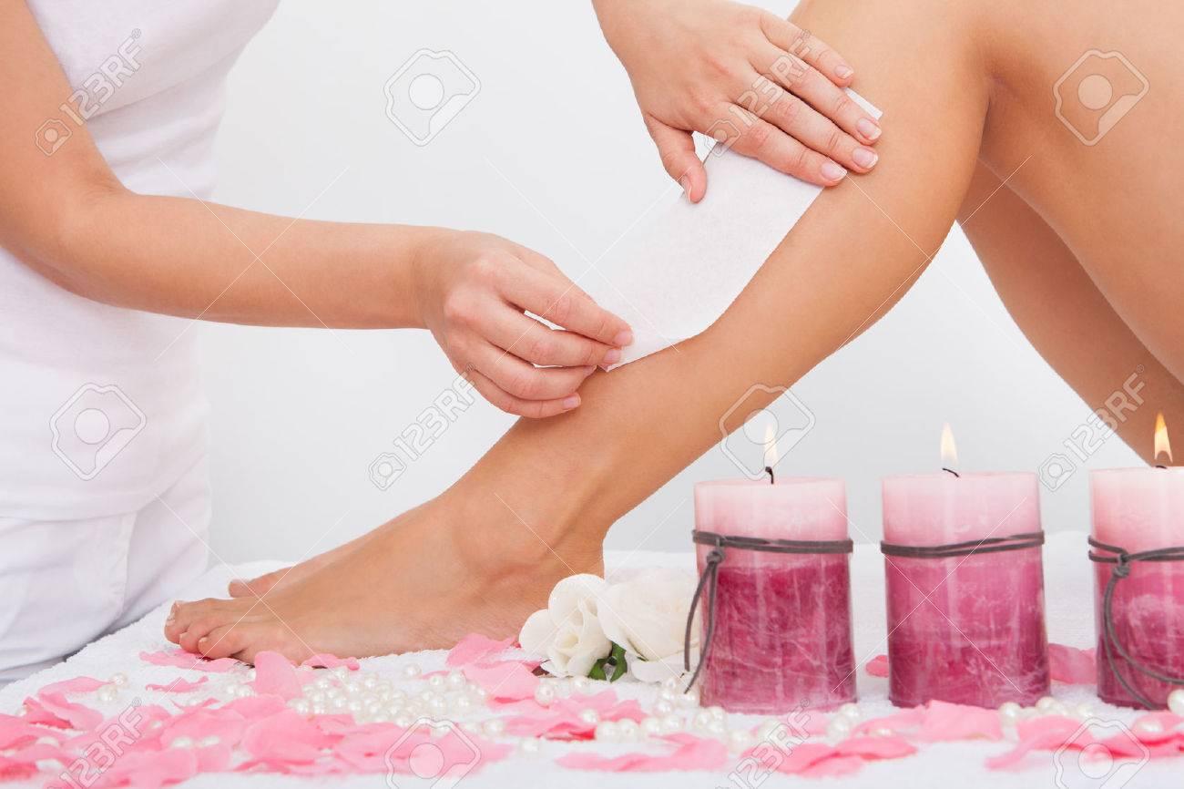 Beautician Waxing A Woman's Leg Applying Wax Strip Stock Photo ...
