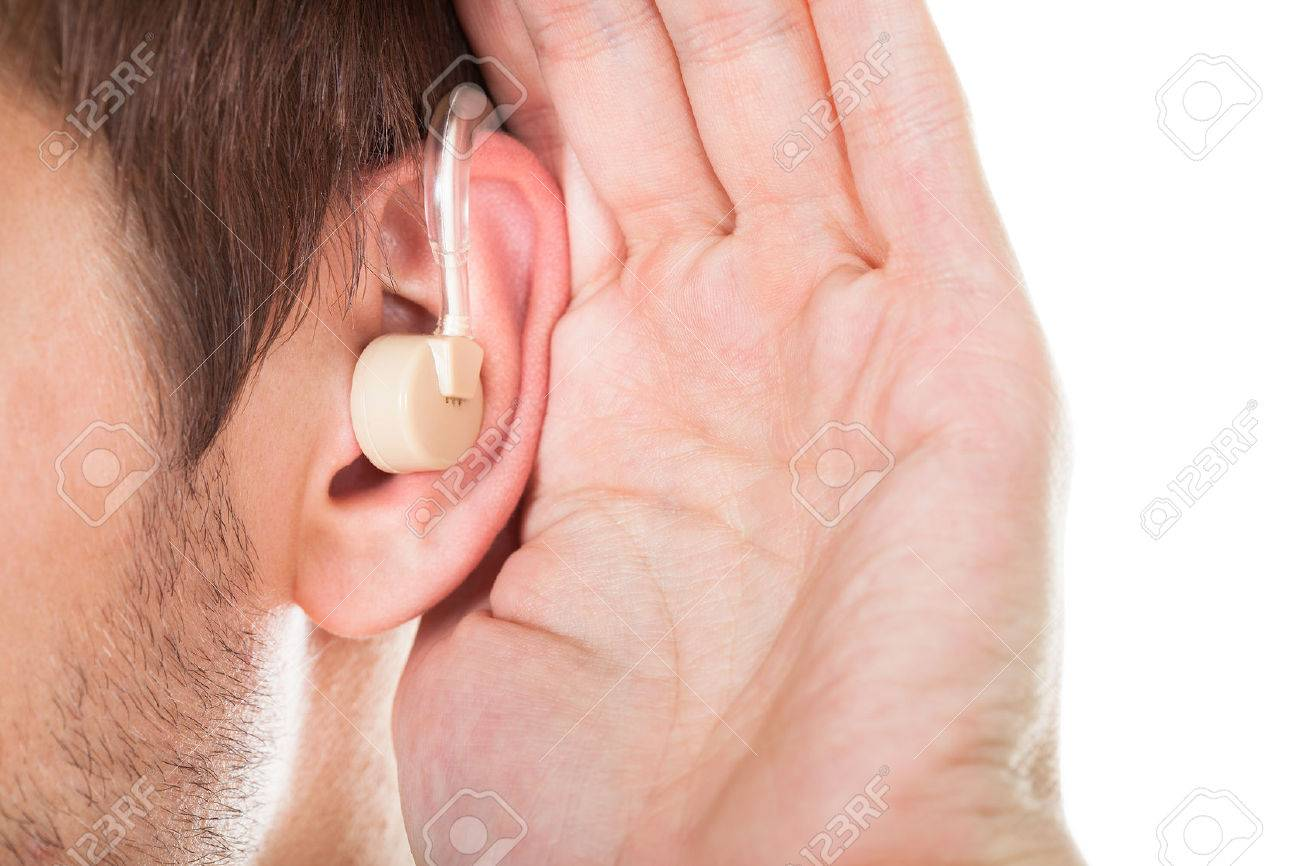 Close-up Of An Ear With Hearing Aid Stock Photo - 24285625
