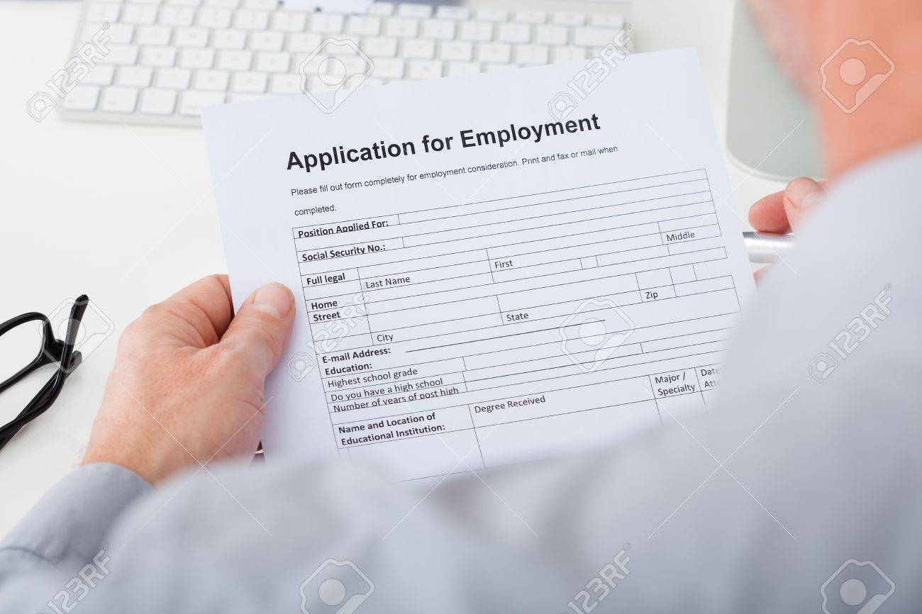 close up of hand filling application for employment stock photo close up of hand filling application for employment stock photo 25045529