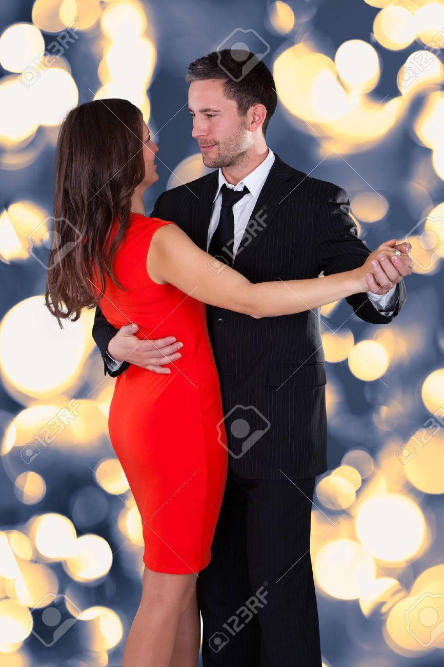 Portrait Of Happy Young Couple Dancing On Bokeh Stock Photo Picture And Royalty Free Image Image 25154830