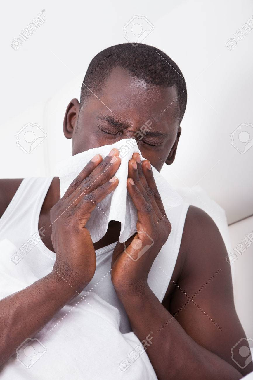 Portrait Of African Man Blowing His Nose In A Handkerchief Stock Photo - 25176509