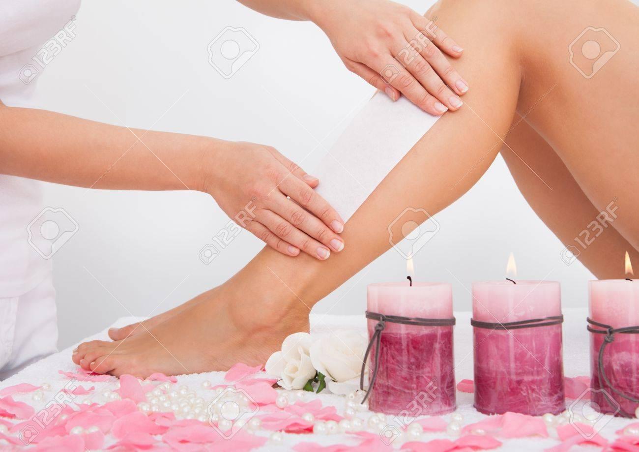 Beautician Waxing A Woman's Leg Applying Wax Strip Stock Photo - 25151260