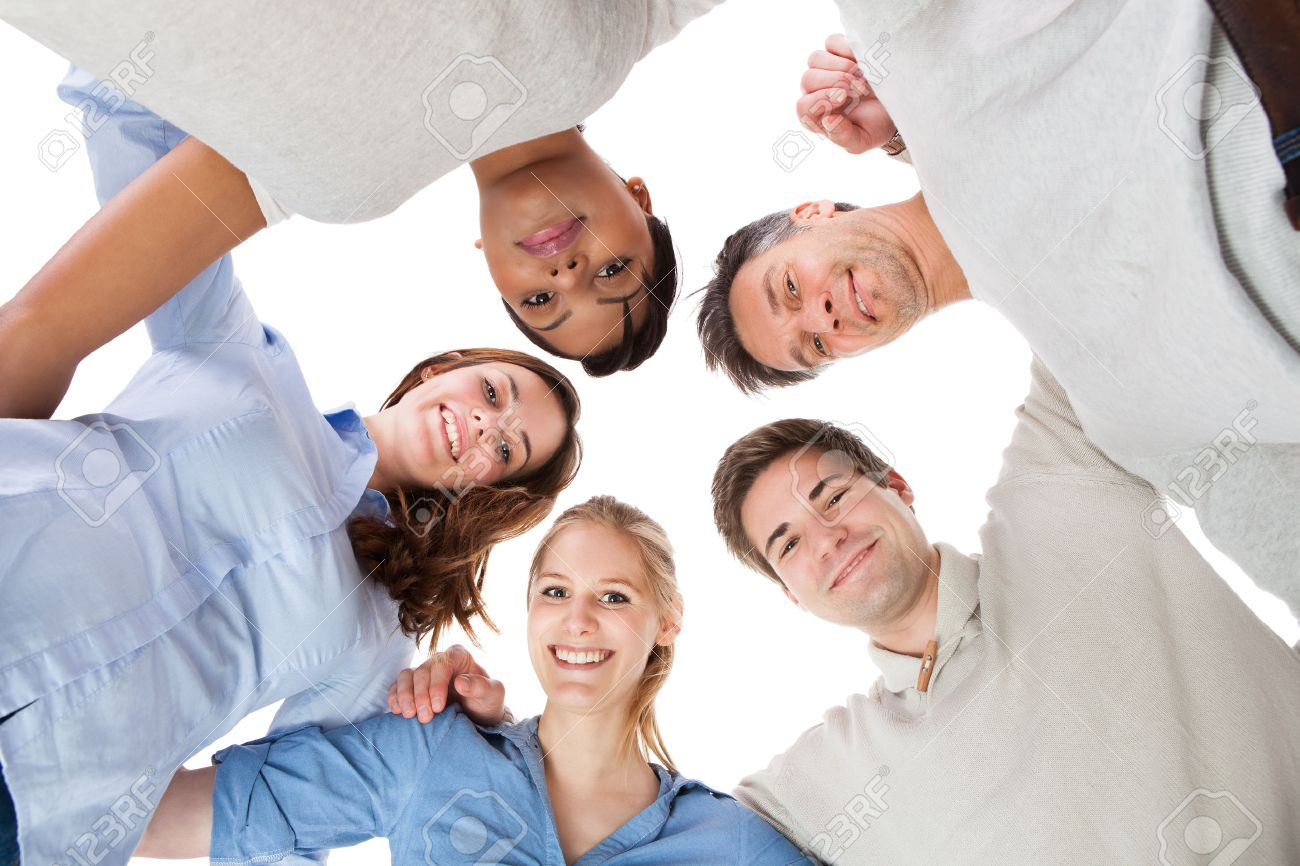 Happy Group Of People In Circle Looking Down Over White Background Stock Photo Picture And Royalty Free Image Image 25538618