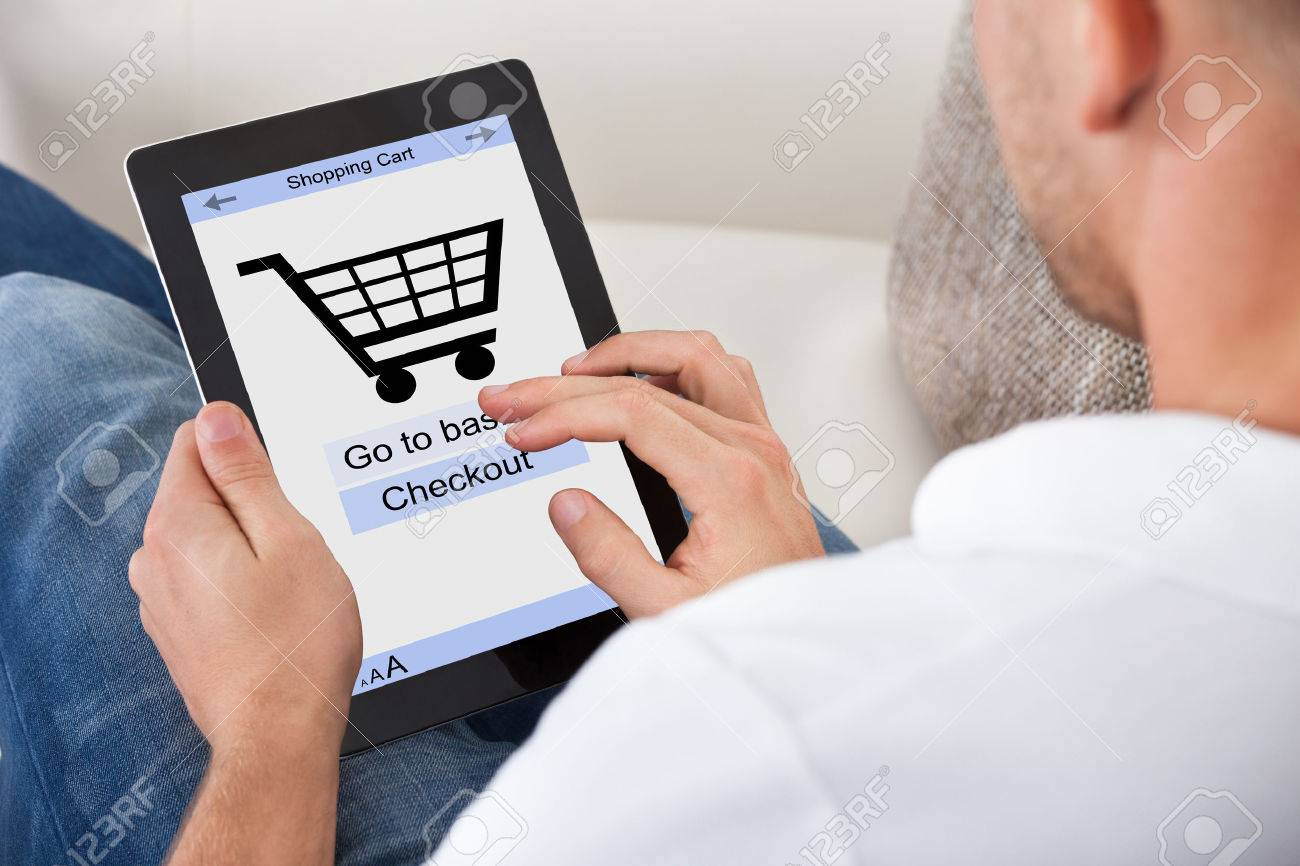 Conceptual Image Of A Man Making An Online Purchase On His Tablet ...