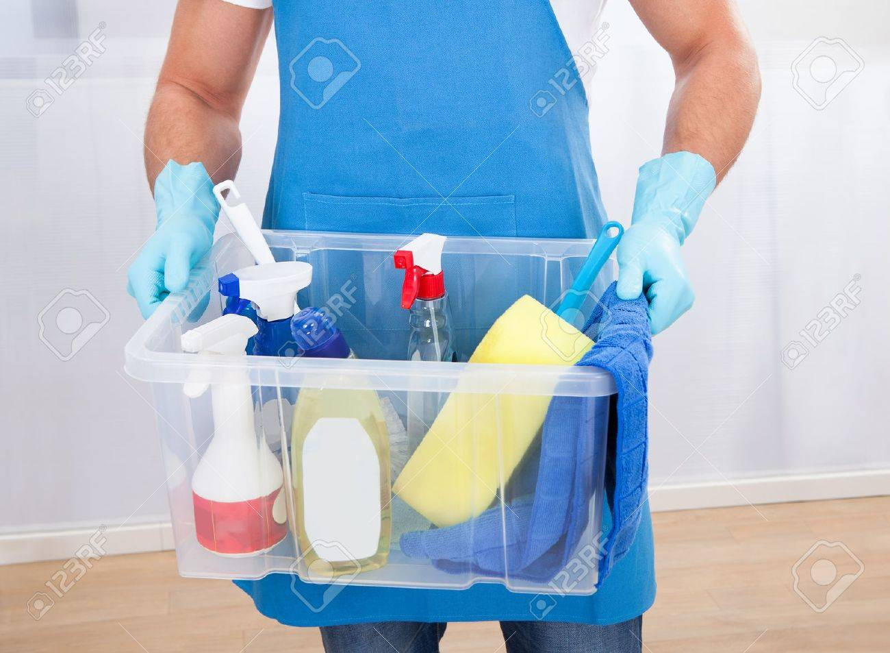Janitor Or Cleaner Wearing An Apron And Gloves Carrying A Tub ...