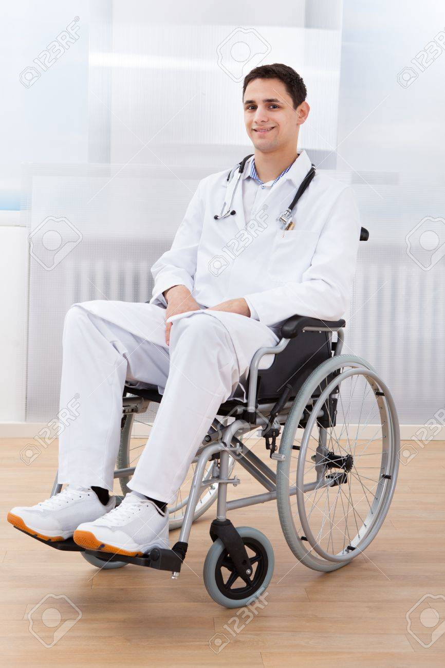 Full Length Portrait Of Handicapped Doctor Sitting On Wheel Chair ...