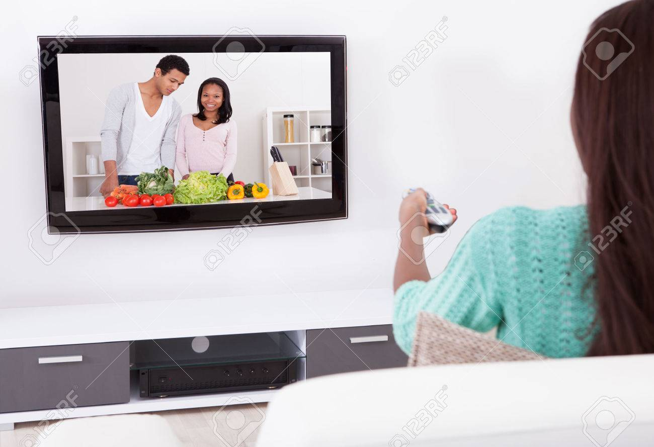 Side View Of Young Woman Watching TV In Living Room Stock Photo ...