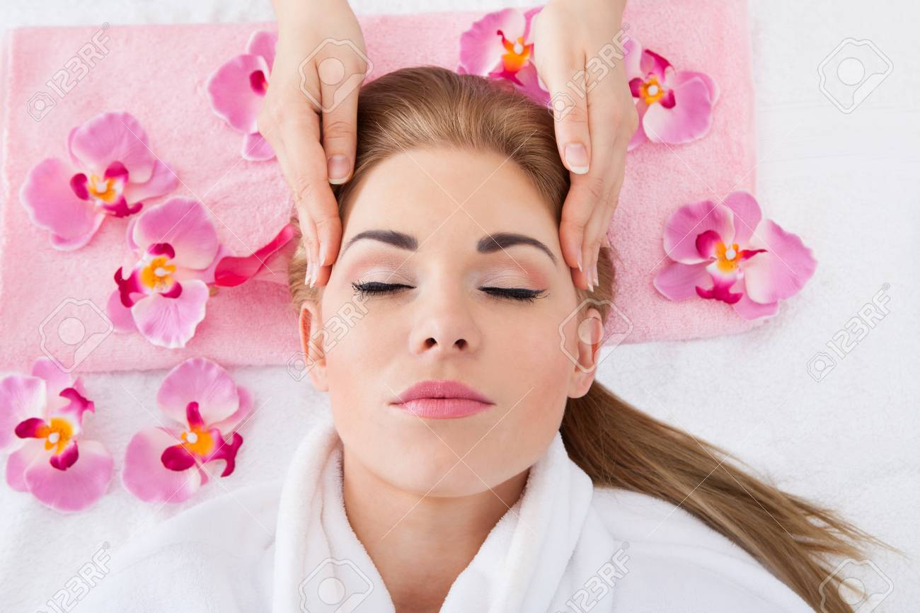 High Angle View Of Young Woman With Eyes Closed Getting Massage Stock Photo - 27241536