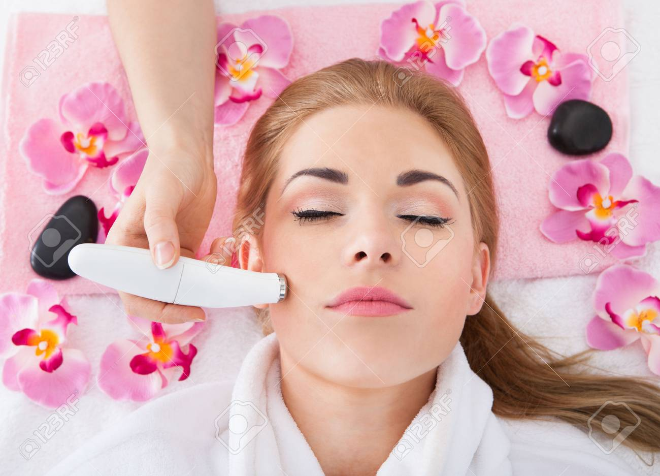 High Angle View Of Woman Getting Microdermabrasion Therapy In Spa Stock Photo - 27242167