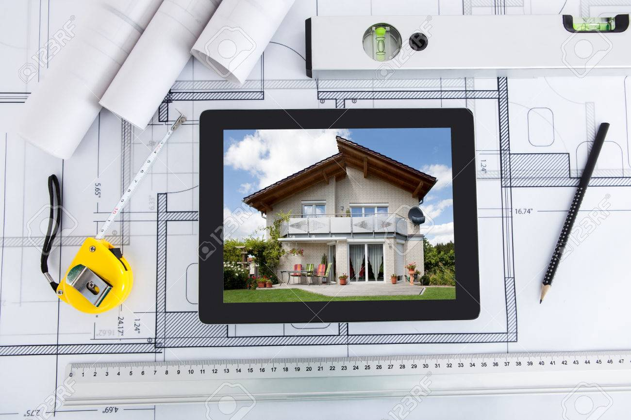 House displayed on digital tablet screen with architects tools over house displayed on digital tablet screen with architects tools over blueprint foto de archivo 27954234 malvernweather Choice Image
