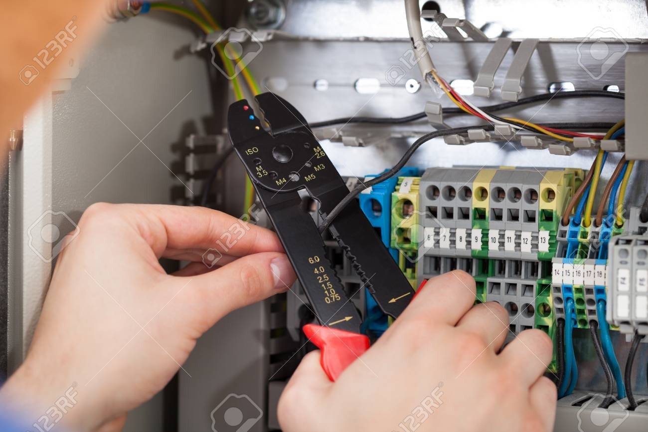Closeup Of Male Technician Cutting Cable With Fusebox In Background Fuse Box Stock Photo 28958674