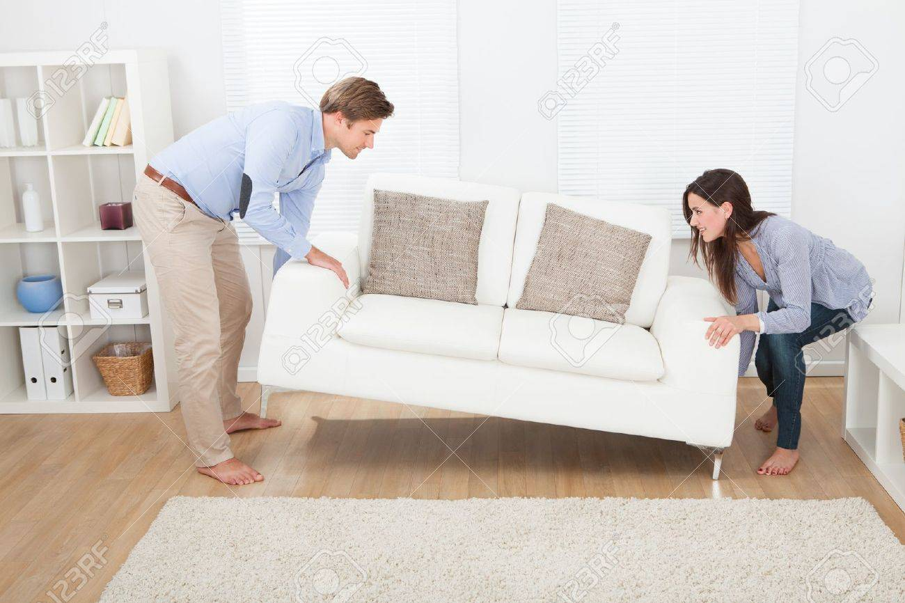Placing Living Room Furniture Full Length Of Happy Couple Placing Sofa In Living Room Of New