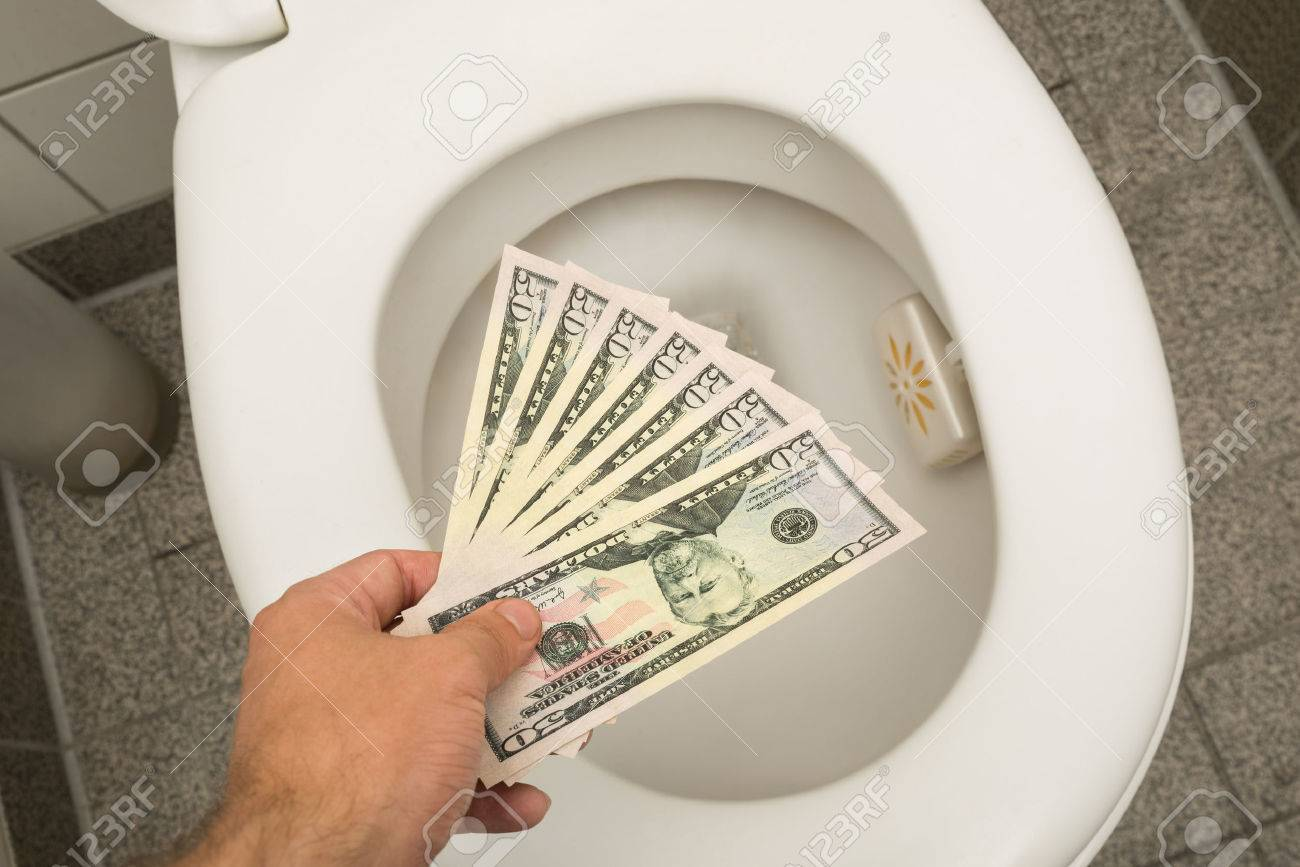 Hand Throwing 100 Dollar Bills In Toilet Stock Photo, Picture And ...