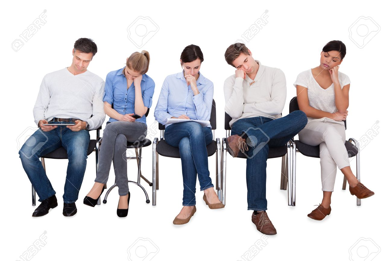 Full length of bored businesspeople sitting on chairs against white background - 33379903