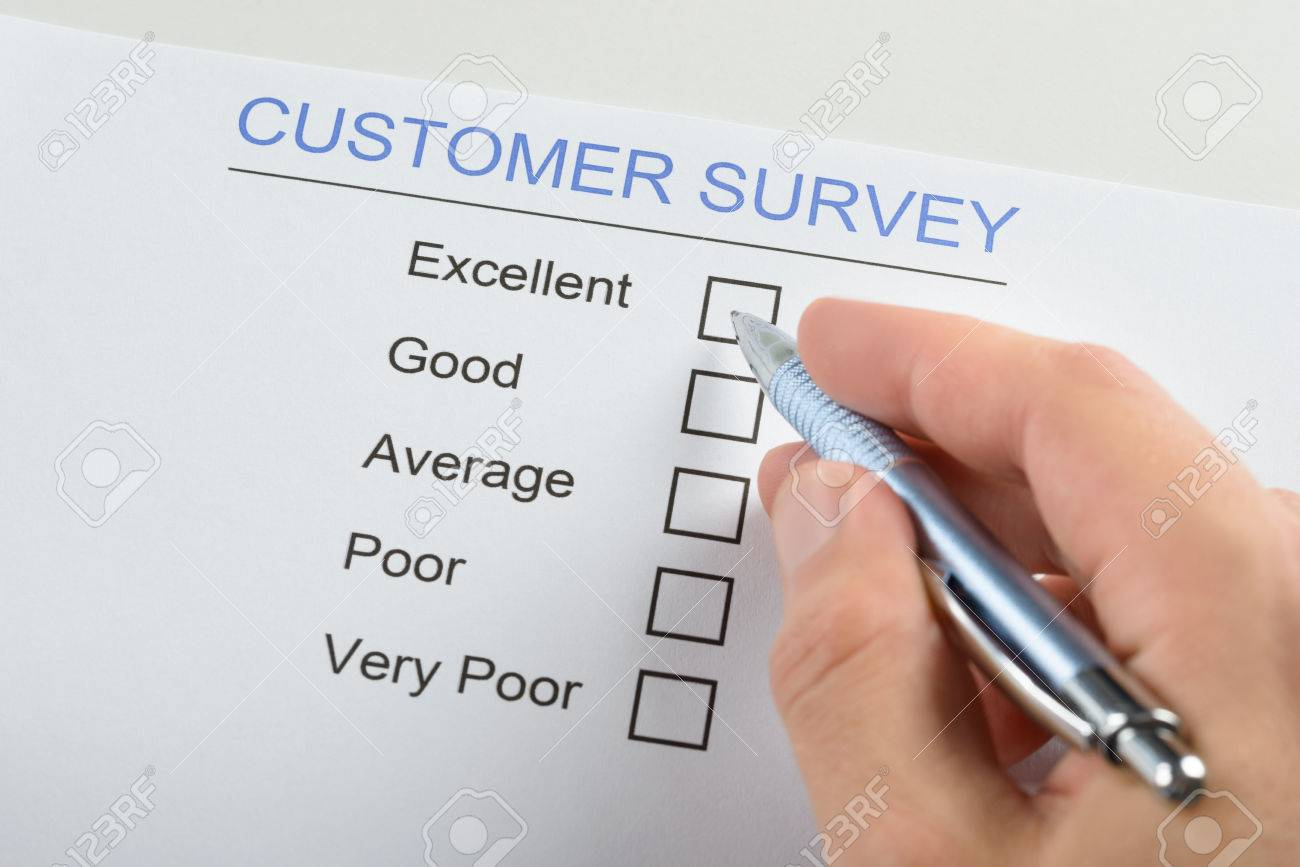 Closeup Of Person Hand Filling Customer Survey Form With Pen – Customer Survey