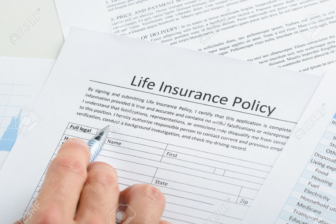 close up of person hand filling life insurance policy application close up of person hand filling life insurance policy application form stock photo 36192858
