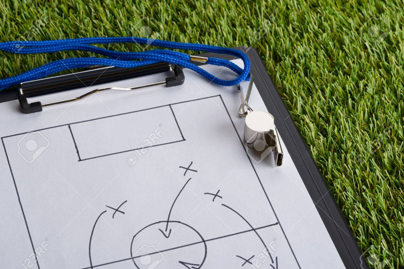 Whistle And Clipboard With Soccer Tactic Diagram On Green Pitch ...
