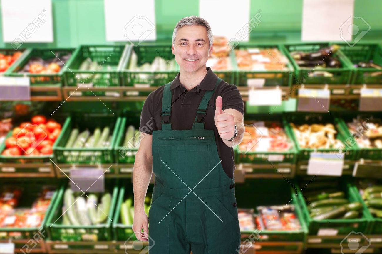 mature male s clerk showing thumb up gesture in supermarket mature male s clerk showing thumb up gesture in supermarket stock photo 36721123