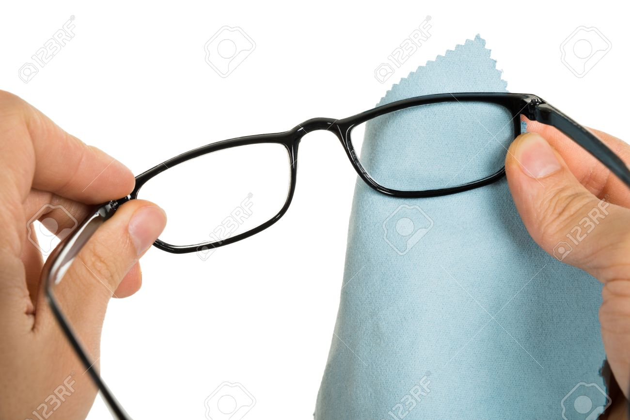 86241f003b Close-up Of Person s Hand Cleaning Eyeglasses With Cloth Stock Photo -  36721312