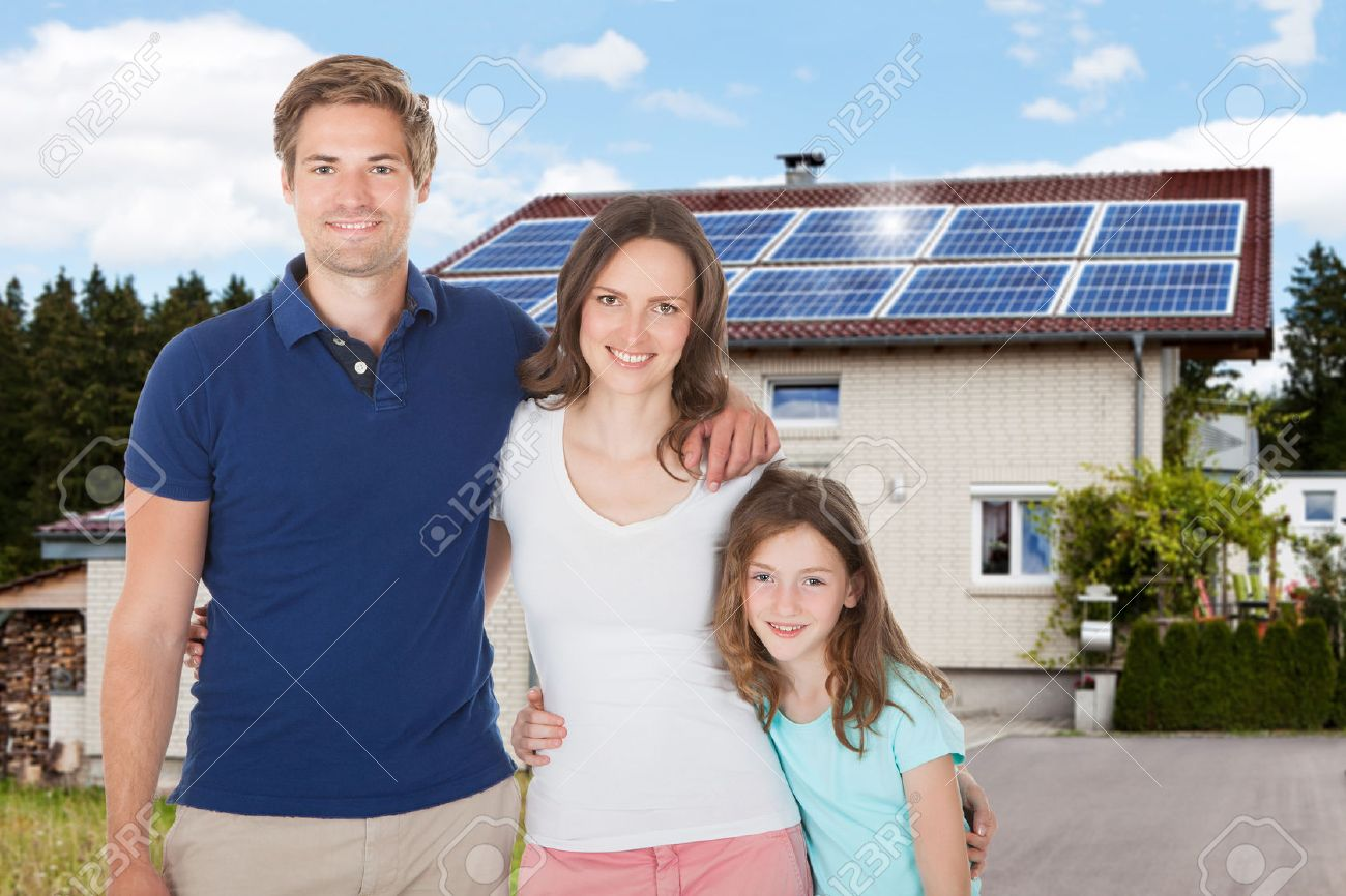 Family Standing In Front House With Solar Panel On Roof - 39119623