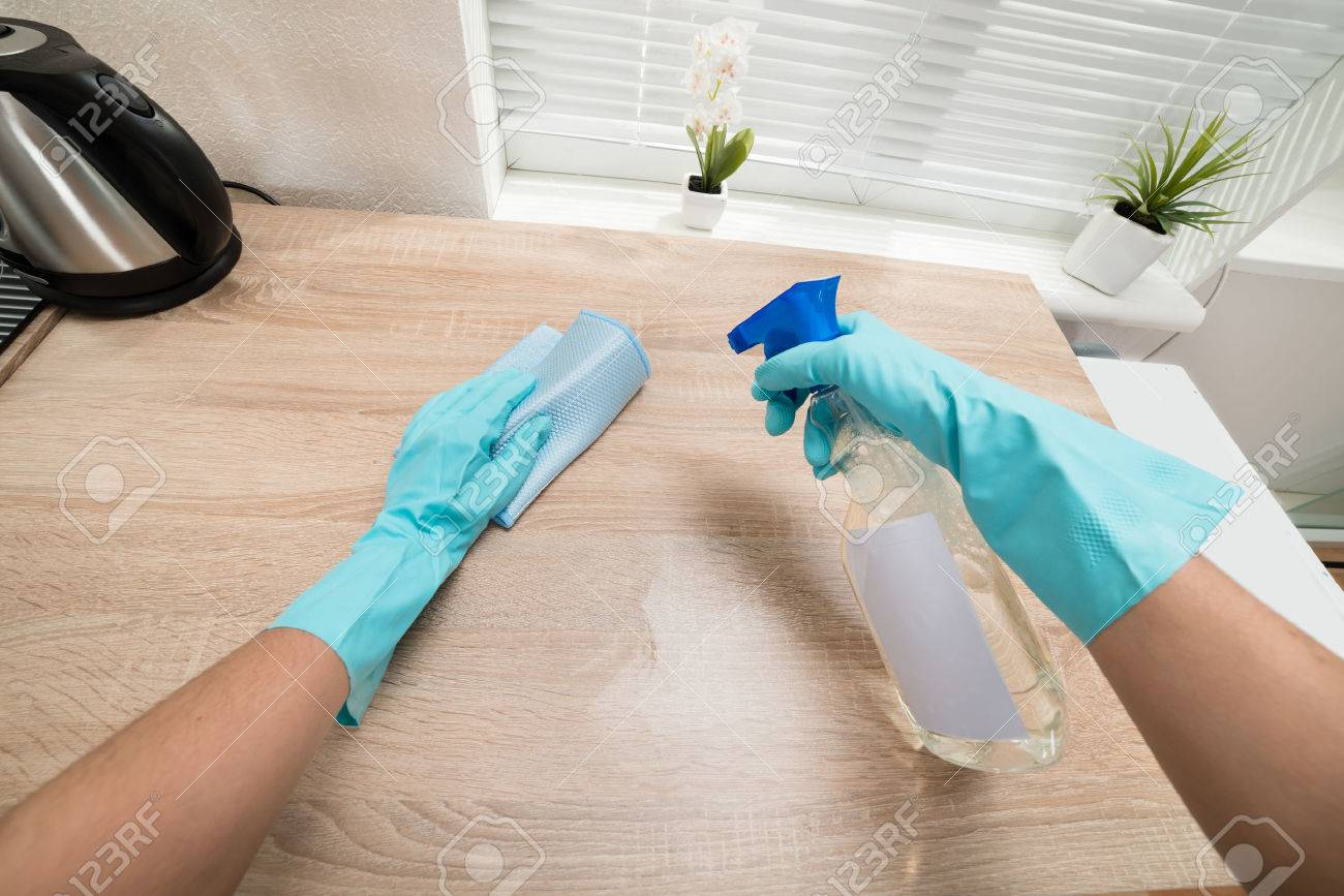 Person Hands In Blue Glove Cleaning Wooden Kitchen Worktop Stock ...