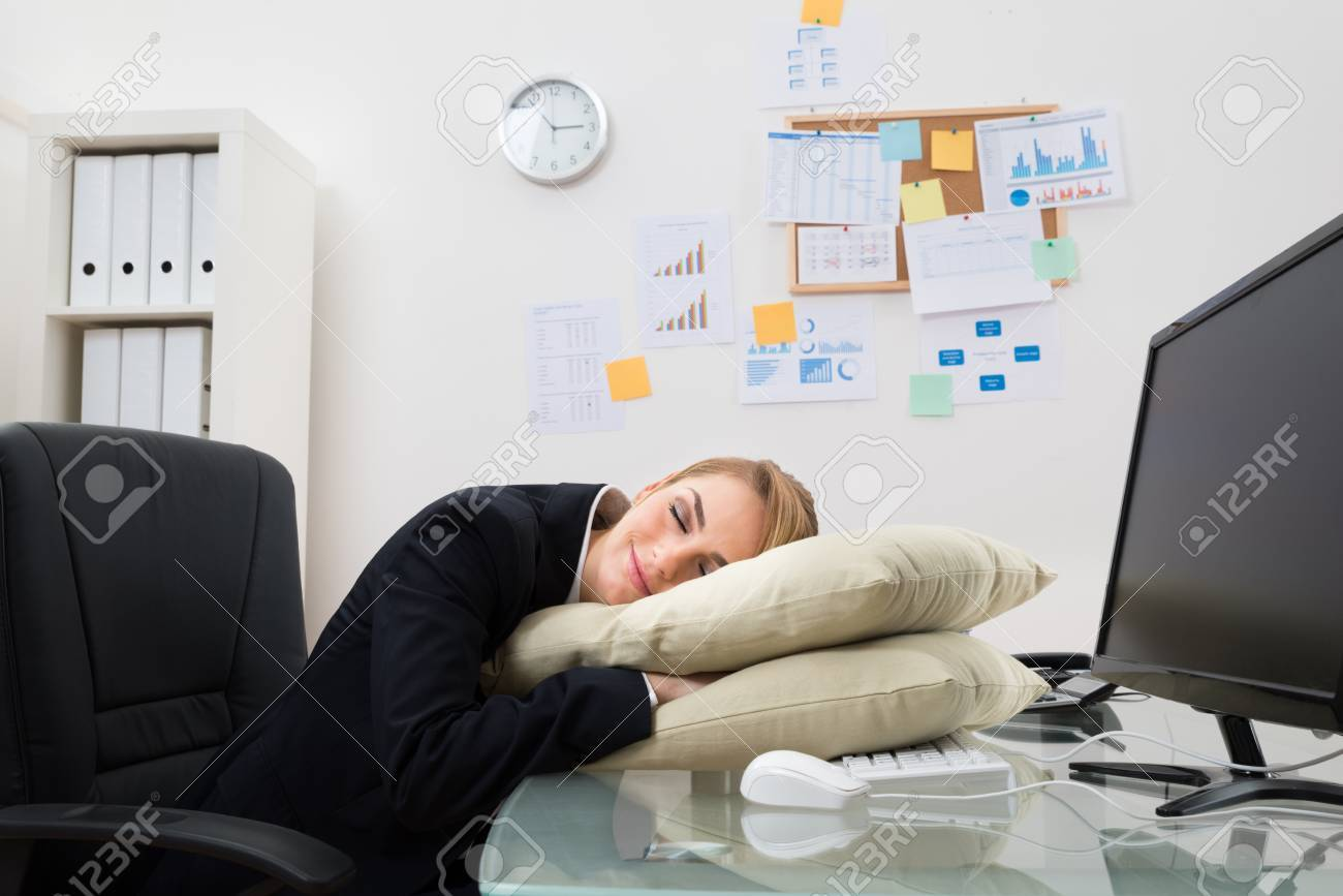 office sleeping pillow. Young Businesswoman Sleeping On Pillow At Desk In Office Stock Photo - 39942603