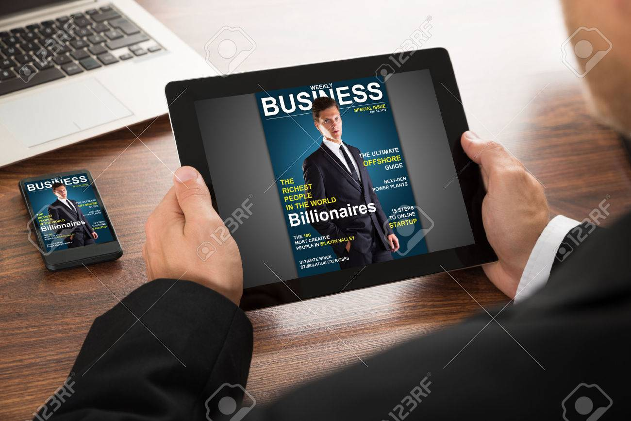 Close-up Of A Businessman Reading Online Magazine On Digital