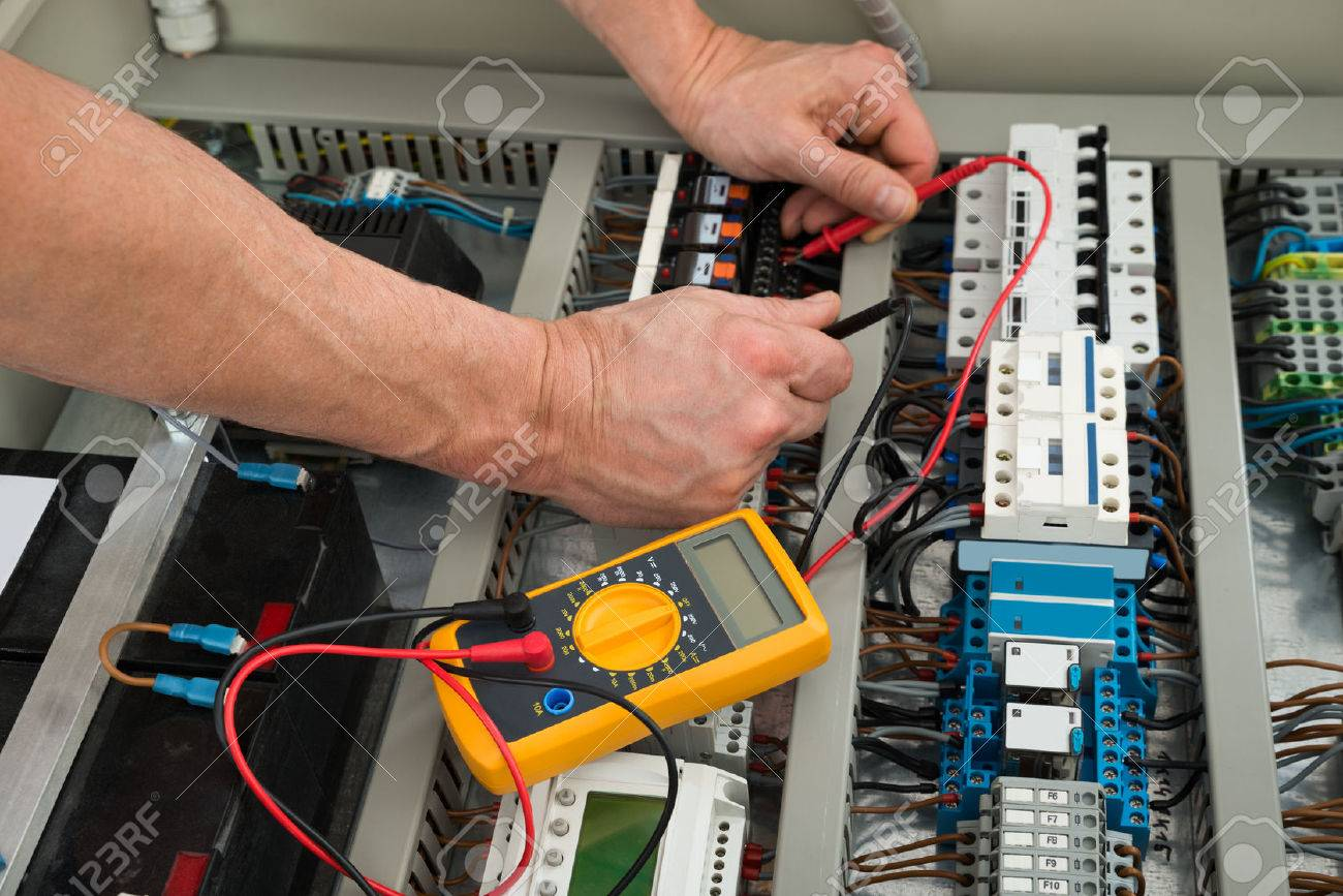 40579676 Close up Of A Electrician Checking Fuse Box With Multimeter Stock Photo close up of a electrician checking fuse box with multimeter stock how to test fuse box with multimeter at webbmarketing.co