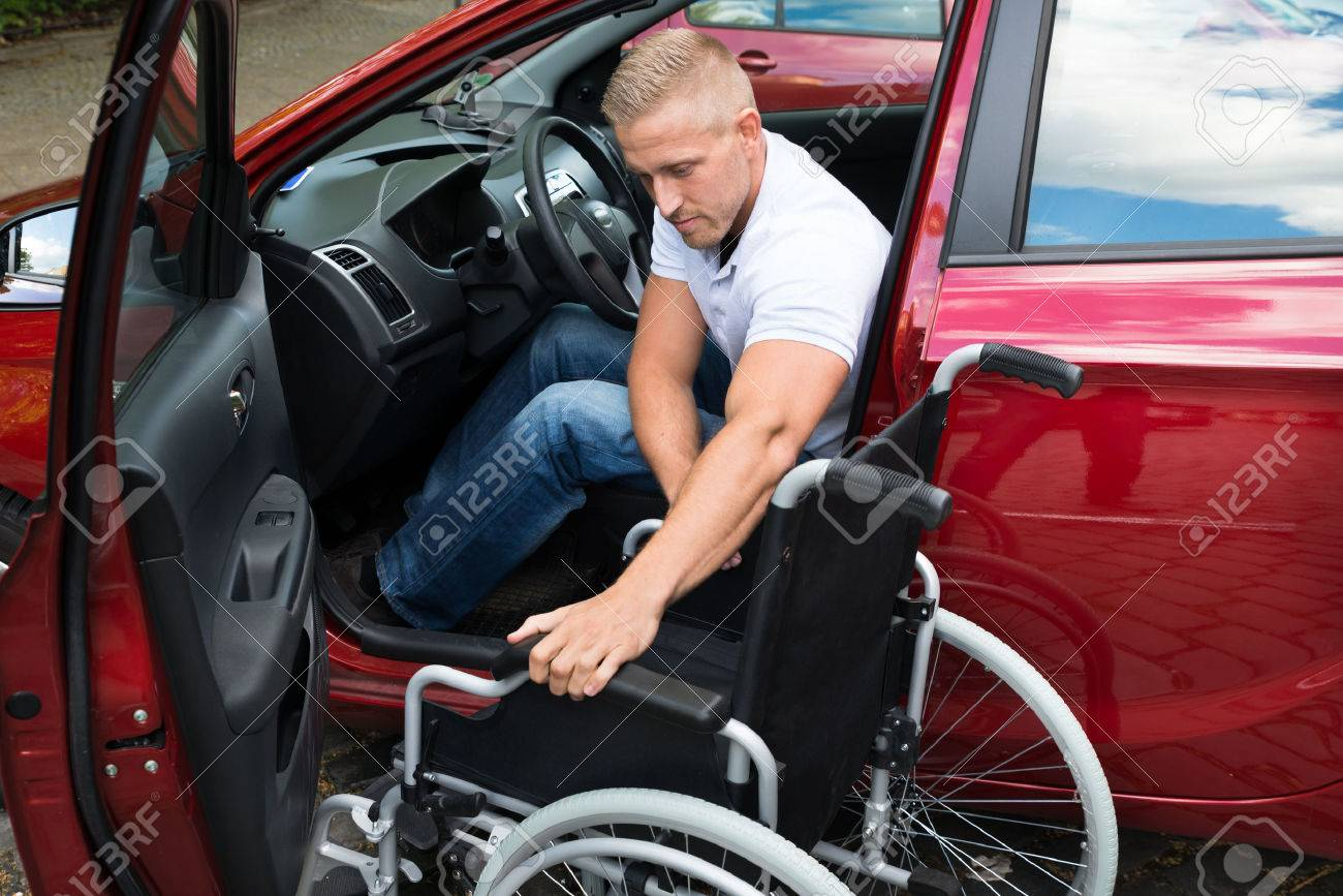 Portrait Of A Handicapped Car Driver With A Wheelchair - 40394409