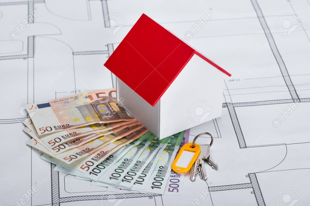 Close up of house model with banknotes and keys on blueprint stock close up of house model with banknotes and keys on blueprint stock photo 41236309 malvernweather Choice Image