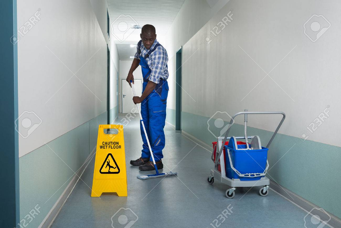 stock photos and royalty images from stock photography janitor cleaning young african male janitor cleaning floor in corridor stock photo