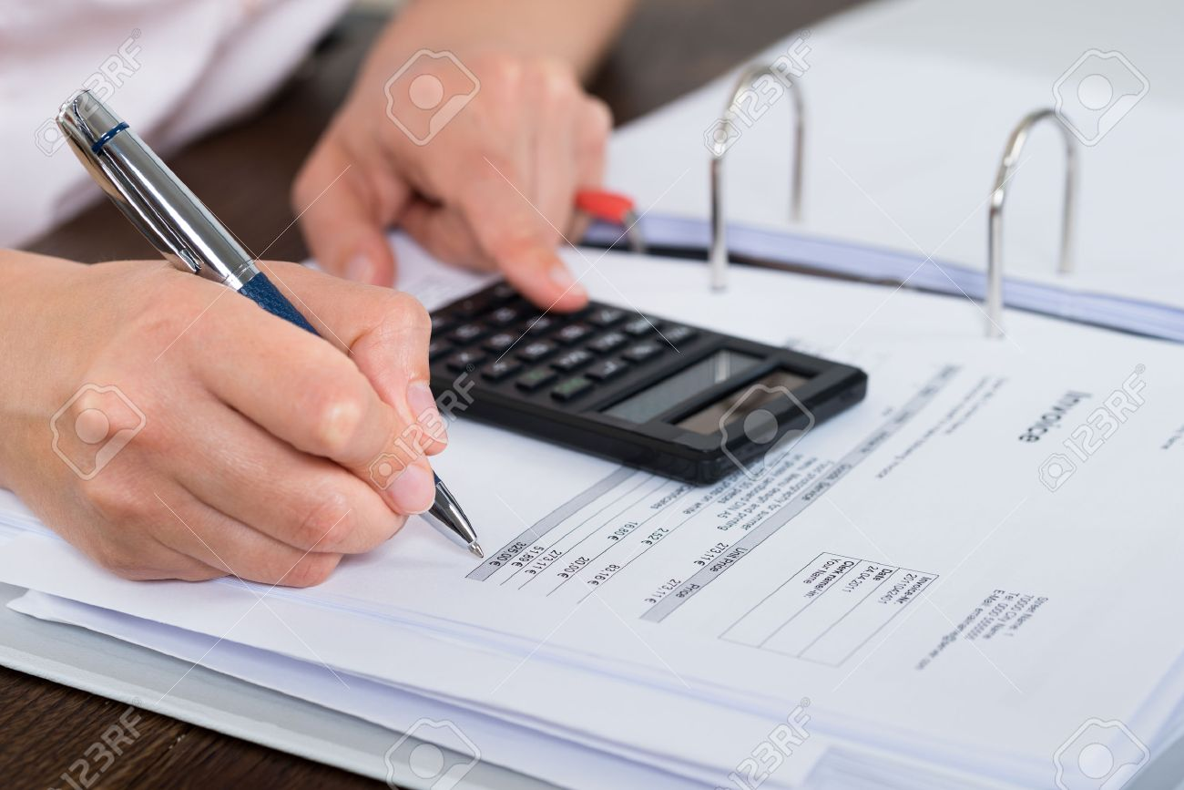 Close Up Of Accountant Doing Calculation With Calculator In Office Stock  Photo   42197407
