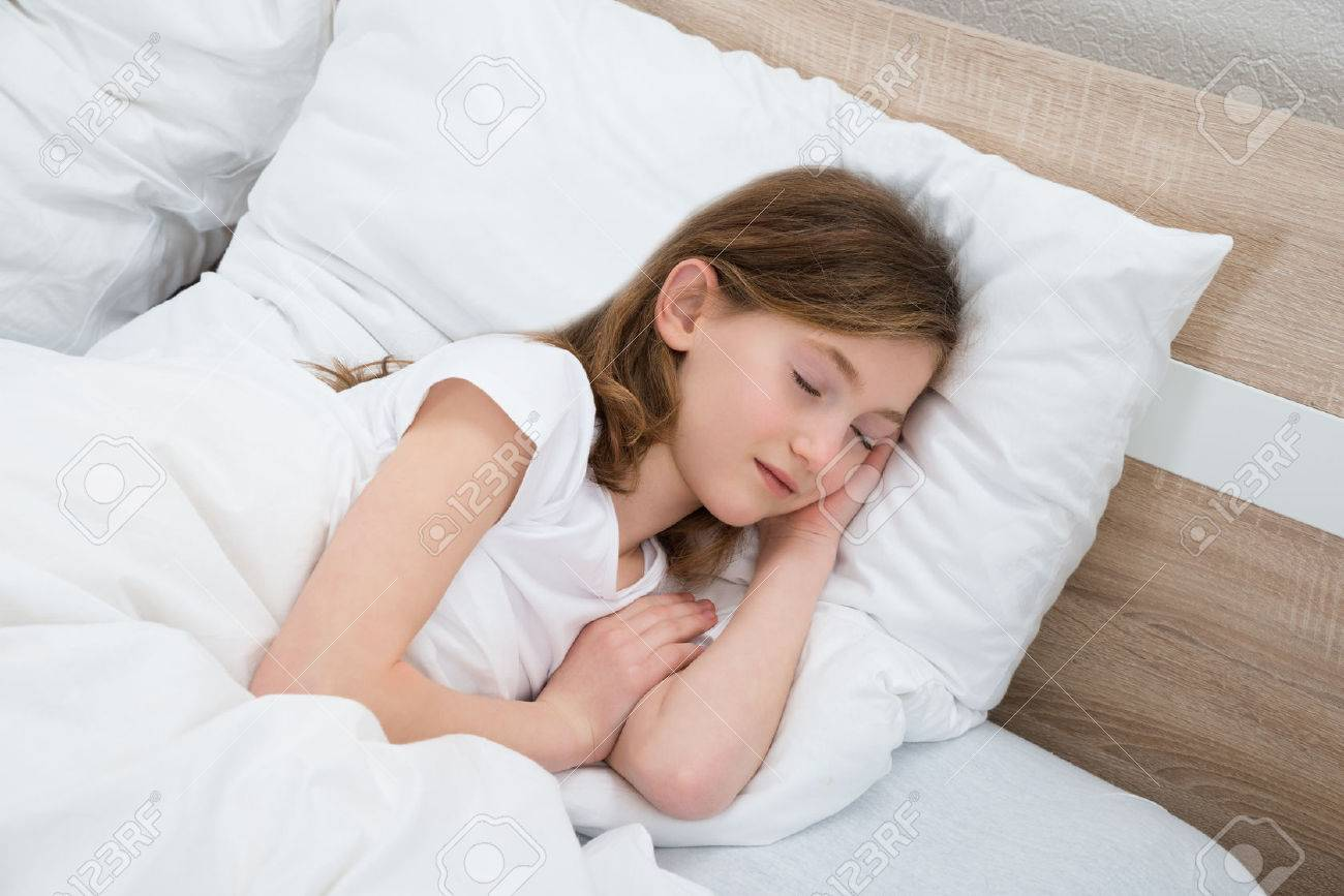 Pillow Alone: Cute Girl Sleeping With White Blanket In Bed