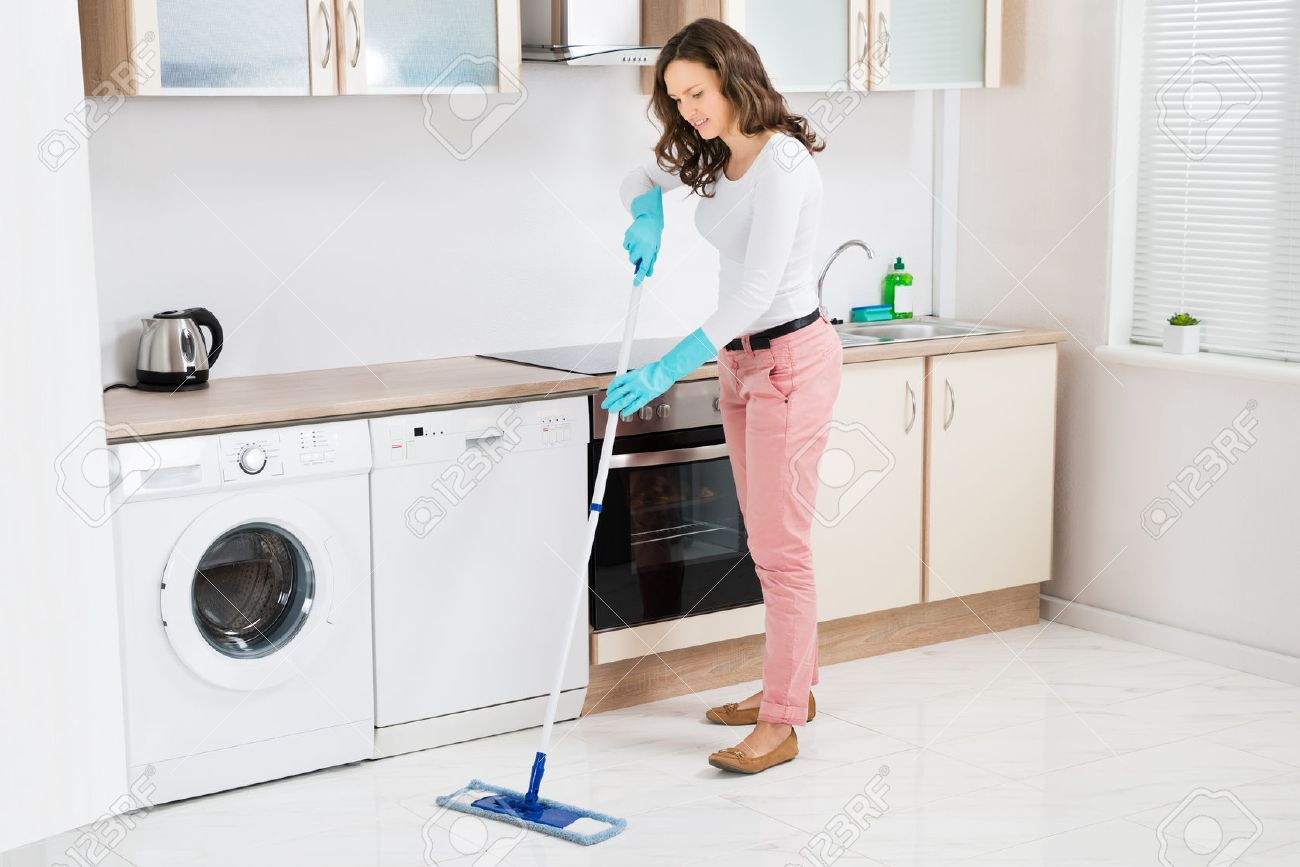 Kitchen Floor Mop Happy Woman Cleaning Floor With Mop In Kitchen At Home Stock Photo