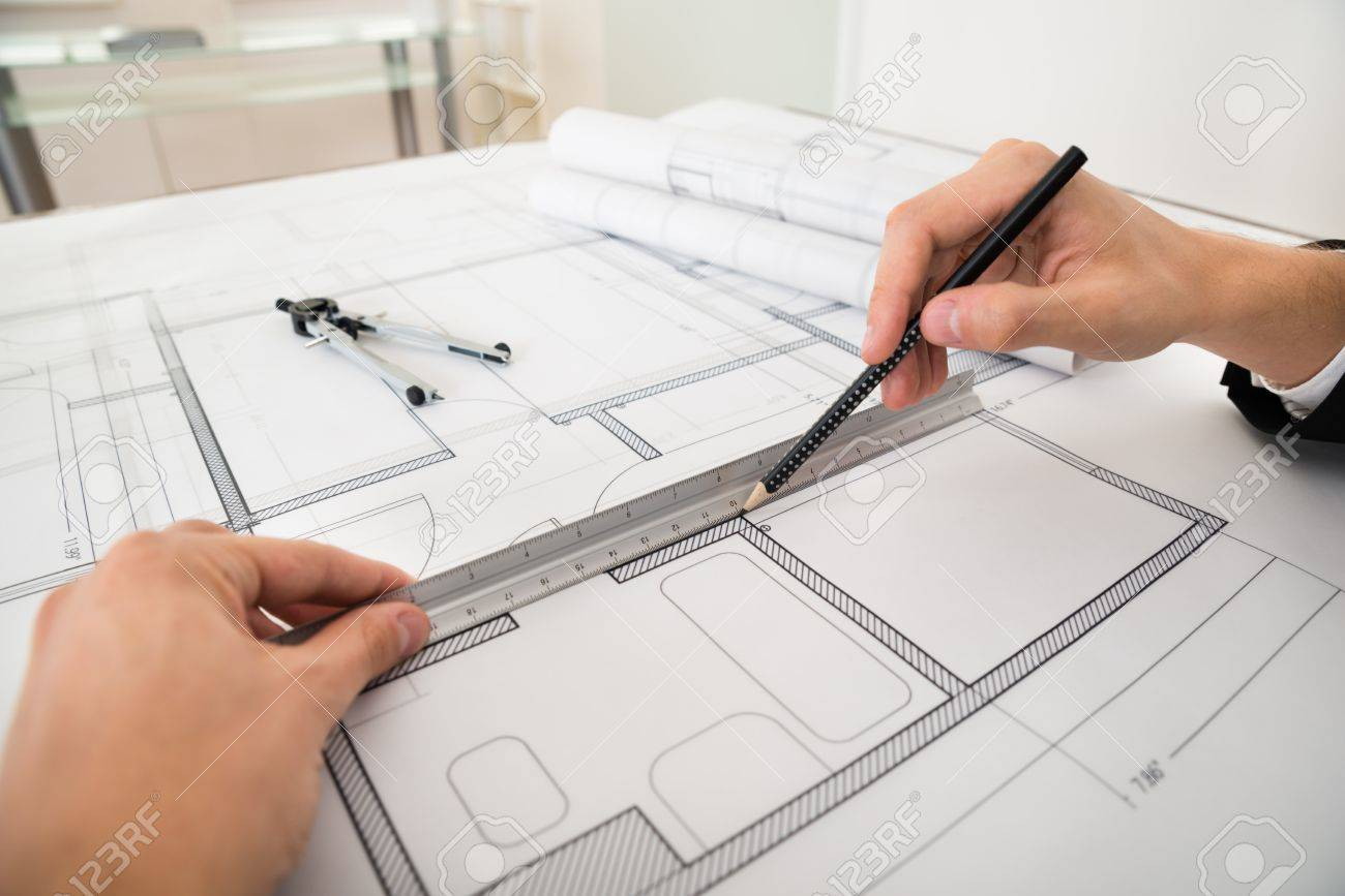 Close up of engineer drawing diagrams with pencil and ruler on close up of engineer drawing diagrams with pencil and ruler on blueprint paper imagens malvernweather Image collections