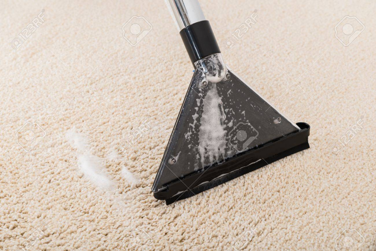 Close Up Of Vacuum Cleaner On Wet Rug Stock Photo   45398339
