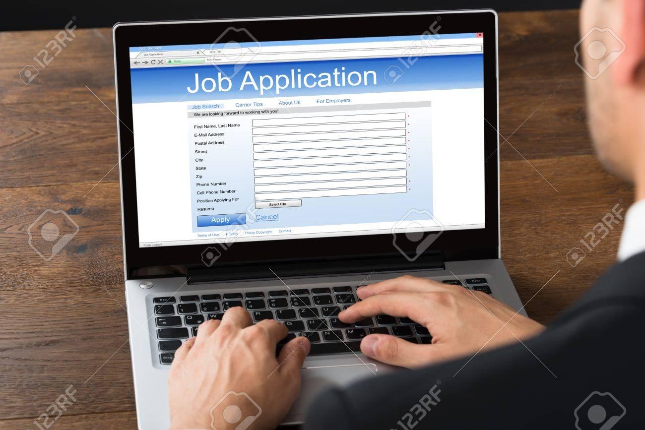 close up of businessman filling online job application form on