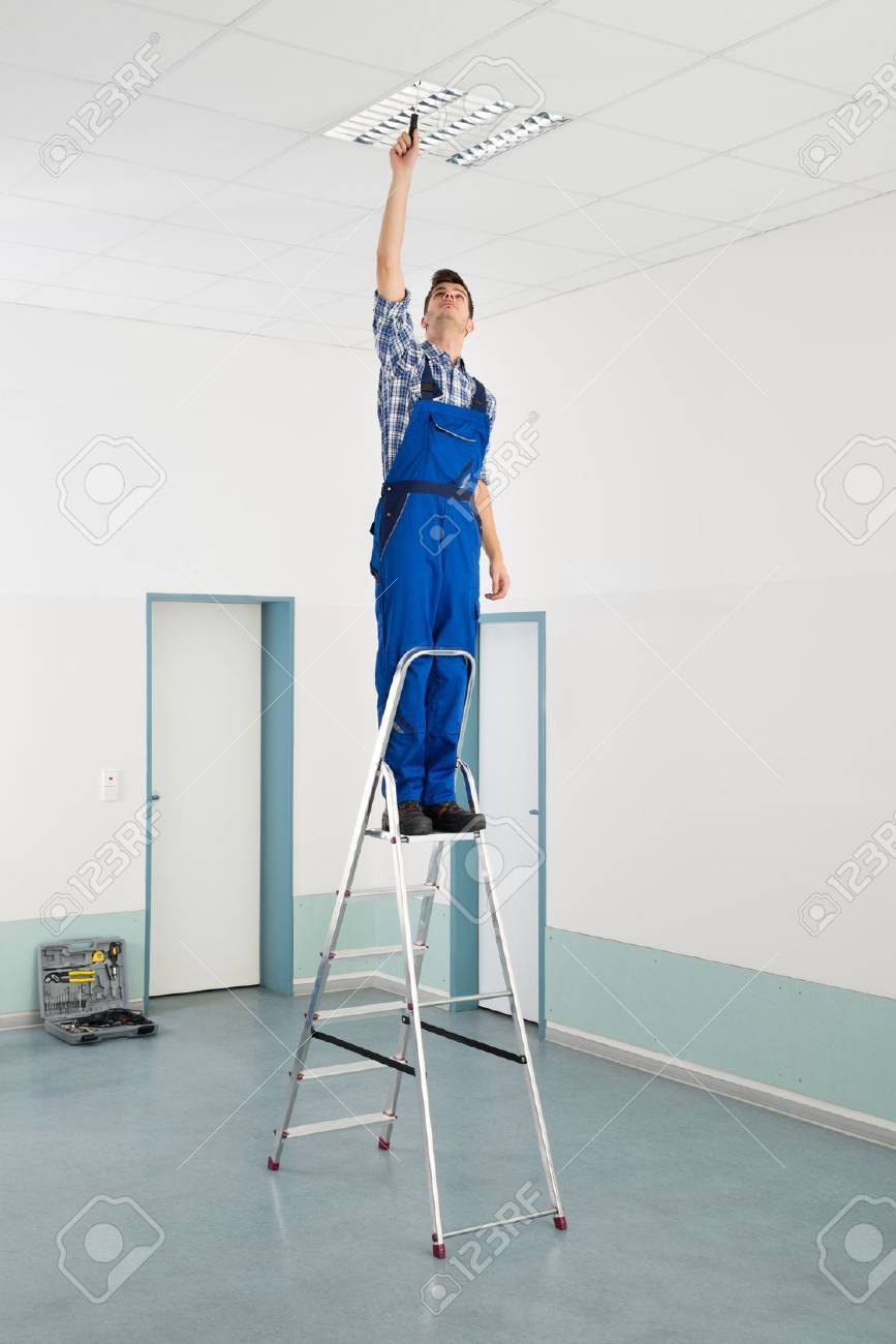 Male Electrician On Stepladder Installing Ceiling Light Stock Photo    45610037