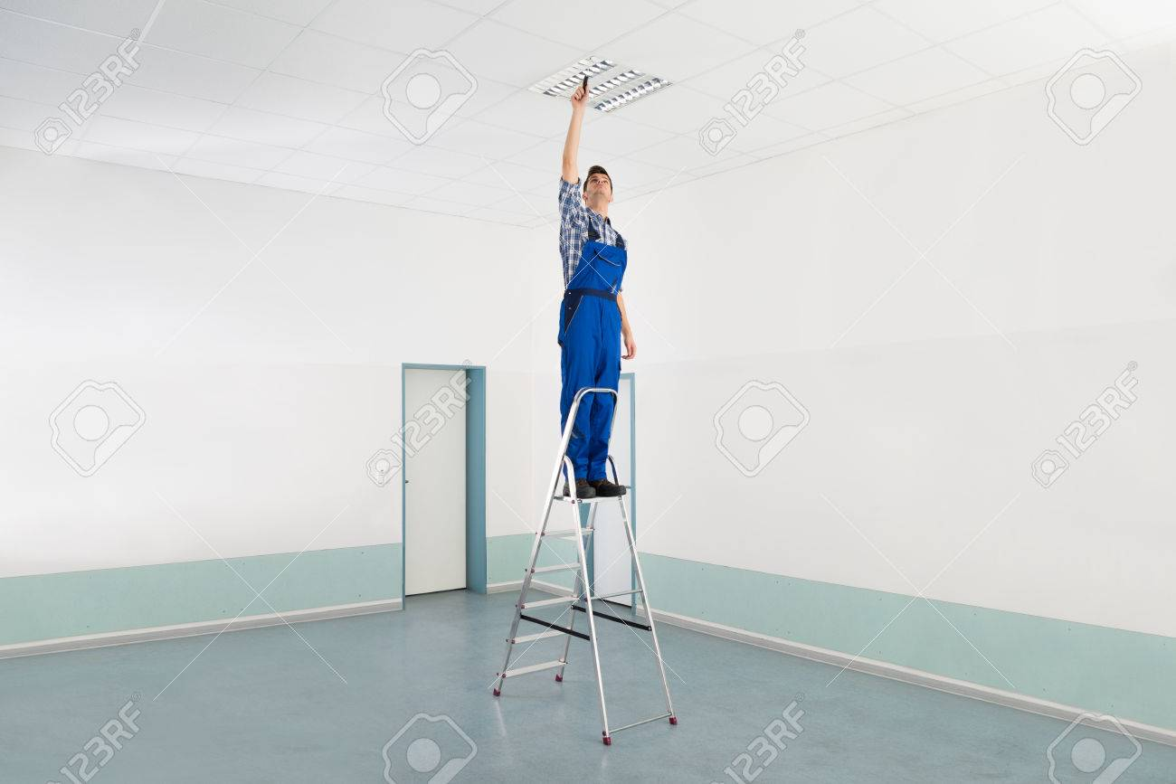 Male Electrician On Stepladder Installing Ceiling Light Stock Photo    45688718