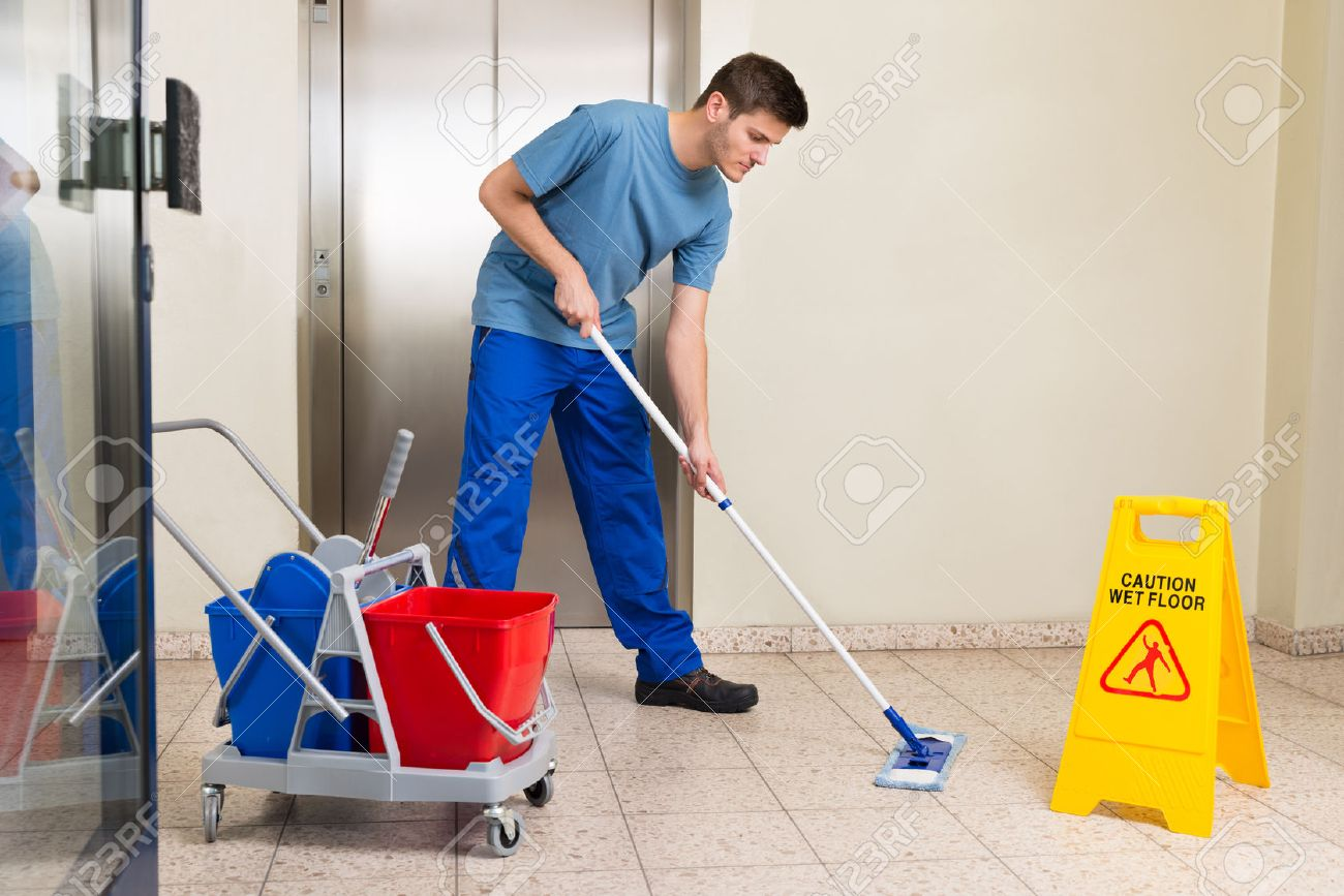 janitor stock photos images royalty janitor images and pictures janitor happy male janitor cleaning equipments mopping floor