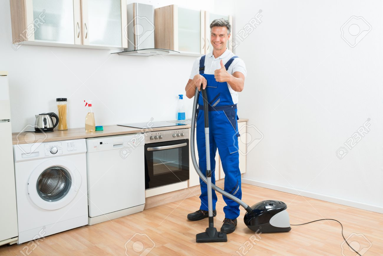 Kitchen Floor Cleaners Full Length Portrait Of Male Janitor Cleaning Floor With Vacuum