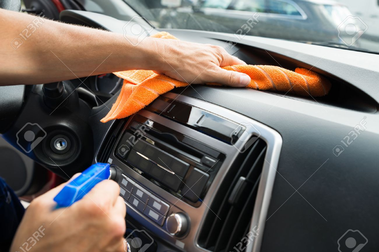 car wash cropped image of mature male worker cleaning car dashboard
