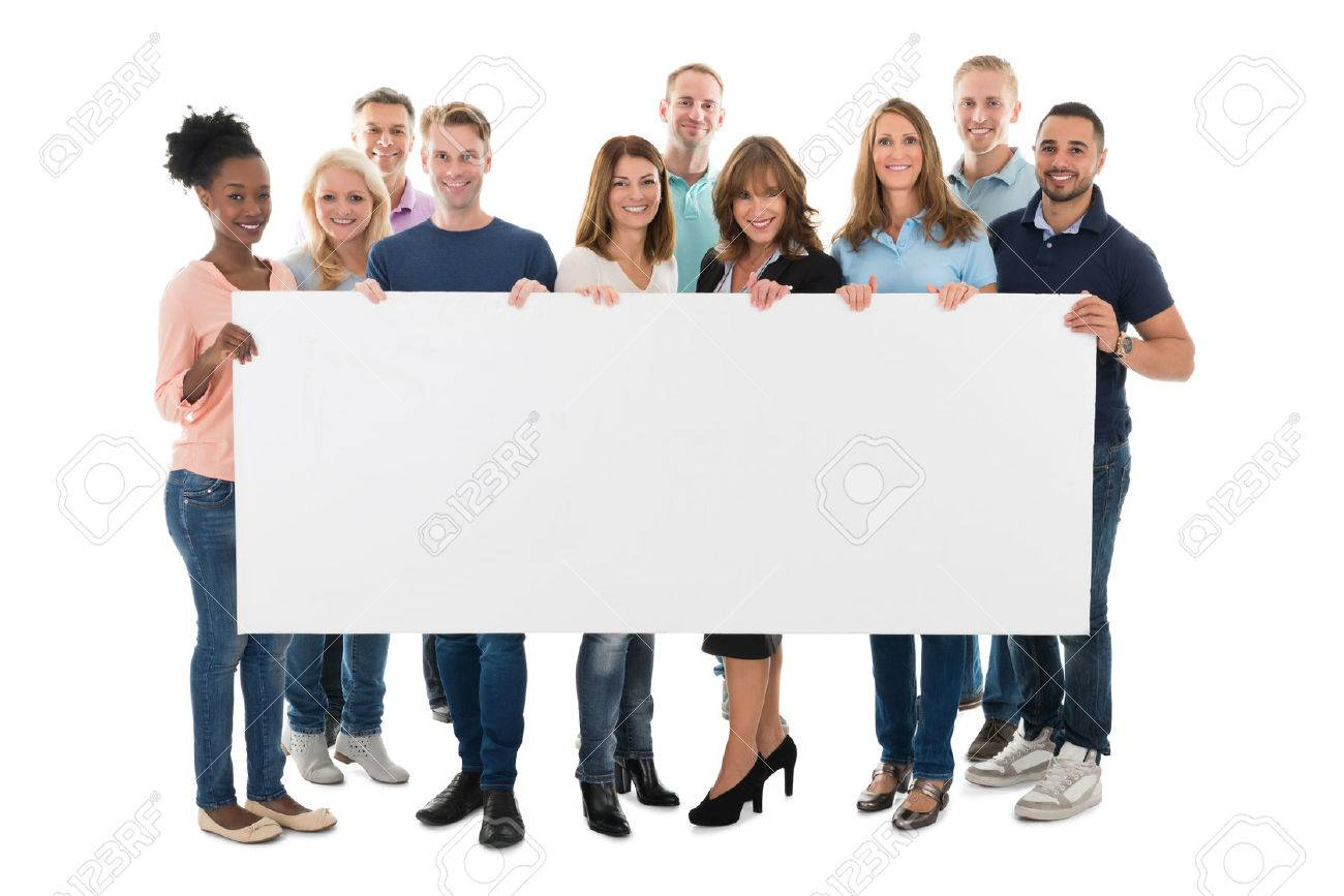 Full length portrait of confident creative business team holding blank billboard against white background - 50245774