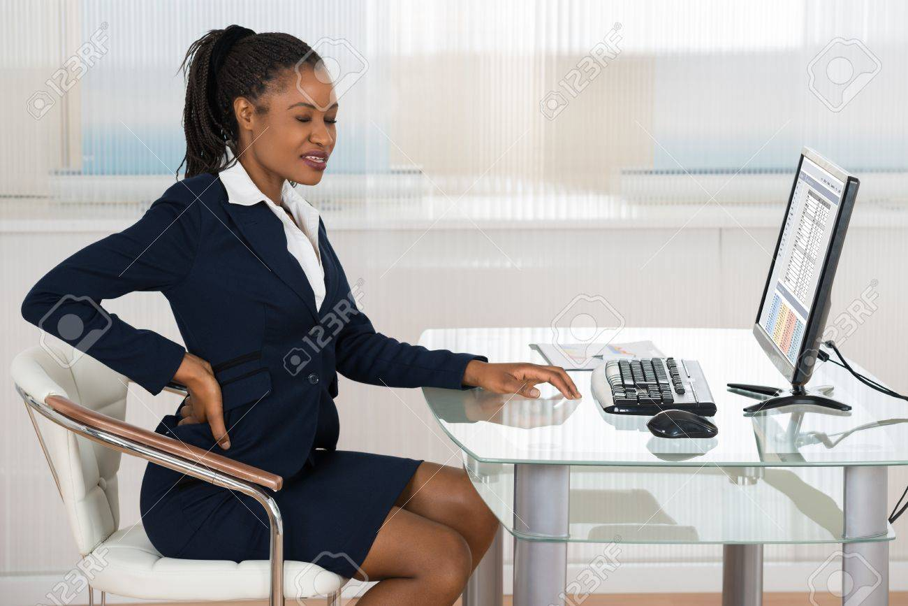 Portrait Of A Young African Businesswoman Suffering From Backache - 50692076