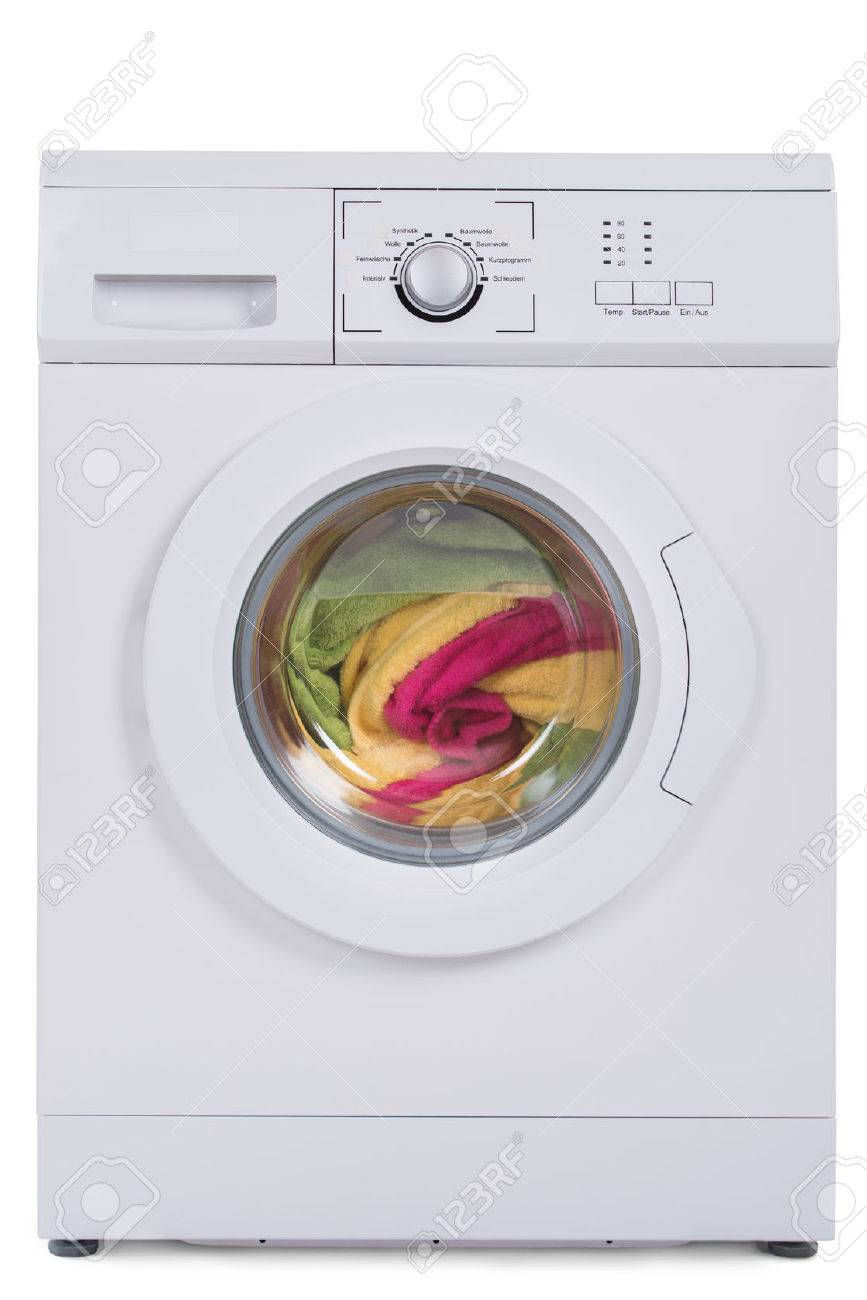 Washing machine full of dirty clothes isolated against blue background - 51726146